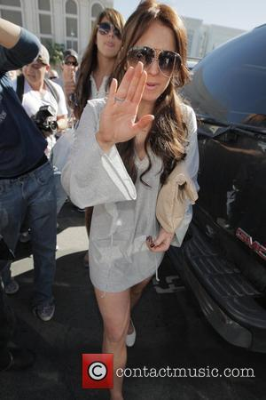 Lohan: Out Of Rehab, Back To Party