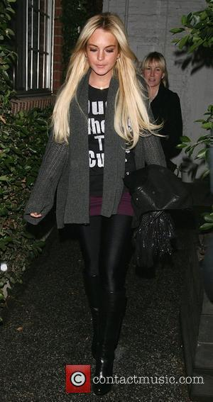 Lohan's Lover Is Following Her To Rehab