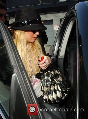 Lohan Promises To Curb Party Antics