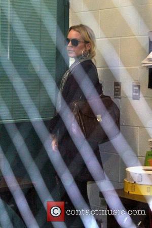 Lohan Gets Her Own Back On Giggling Hilton