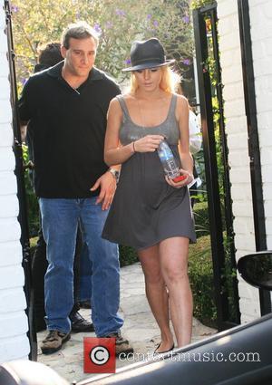 Lohan's Father Halts Custody Battle To Help Lindsay