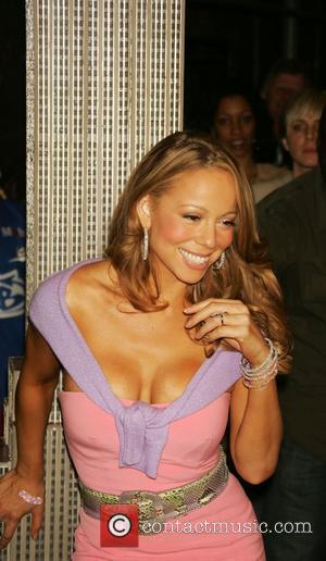 Carey Threatens Legal Action Against Porn Star