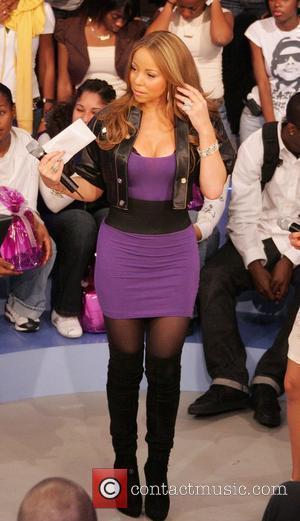 Mariah Carey Scores 18th Us Number Single Overtaking Elvis