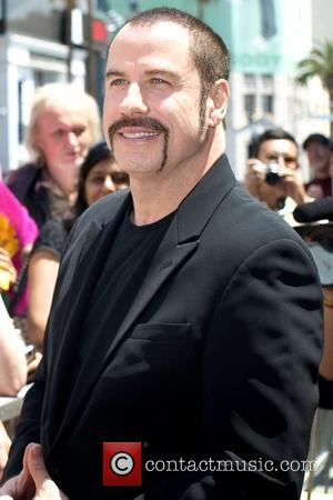 Travolta Loses Weight As A Woman