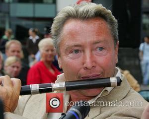 Dancer Michael Flatley plays the flute as he arrived for the launch of the Sligo Live Festival 2007  Sligo,...