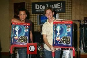 Stephen Colletti and Lee Norris pose with the popular dancing arcade game, Dance Dance Revolution Melanie Segal's 2007 MTV Movie...