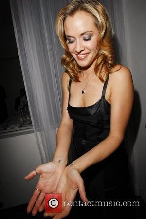 Kristanna Loken tattoos MylifE Charity Dinner & Fashion Show at the Bangaluu Club Berlin, Germany 31.01.08