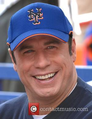 Travolta Flies In For Scientology Lessons