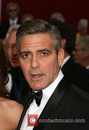 Has Clooney Got A New Smile?
