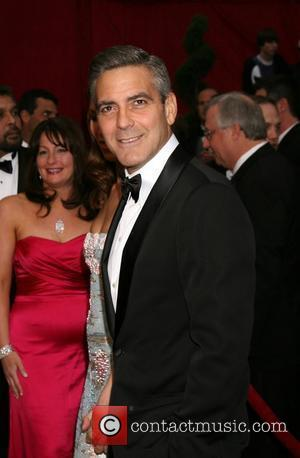 Campaigning Clooney Advised By Bono