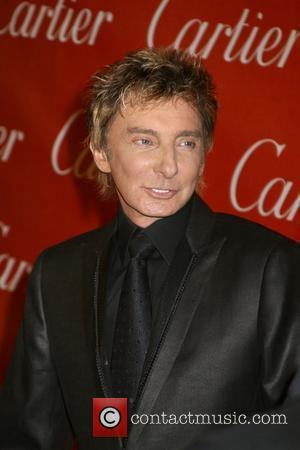 Manilow Hip Operation Goes 'Swimmingly'