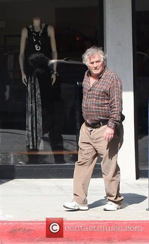 Columbo star Peter Falk appears to be dazed and confused as he walks around Beverly Hills Los Angeles, California -...