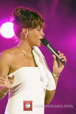 Houston Loses Her Voice At Caribbean Concert