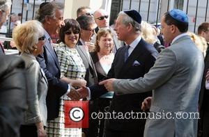 Prince Charles, Prince of Wales, wearing a Jewish yarmulka, meets wellwishers outside the Krakow Jewish Community Centre Krakow, Poland -...