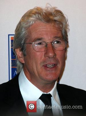 Gere Bemused By Kiss Storm