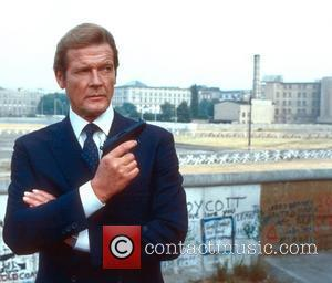 *SIR ROGER MOORE CELEBRATES HIS 80TH BIRTHDAY ON 14TH OCTOBER 2007  Roger Moore  (as James Bond) 'Octopussy' (1983)...