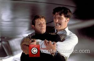 *SIR ROGER MOORE CELEBRATES HIS 80TH BIRTHDAY ON 14TH OCTOBER 2007  Roger Moore (as James Bond) and Richard Kiel...