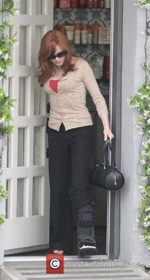Rose McGowan leaves the Neil George Salon in Beverly Hills with her foot in a cast Los Angeles, California -...