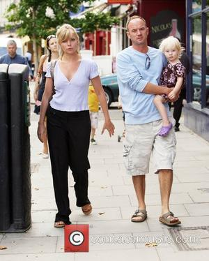 Samantha Janus in Primrose Hill with her husband Mark Womack and two children Benjamin and Lily-Rose before returning to the...