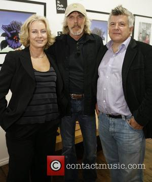 Scott Gorham (centre) of Thin Lizzy attends the launch of 195 limited edition signed prints of Black Rose album cover...