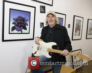 Scott Gorham of Thin Lizzy attends the launch of 195 limited edition signed prints of Black Rose album cover at...