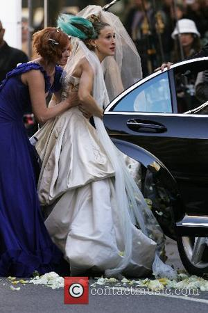 Cynthia Nixon and Sarah Jessica Parker  on the film set for 'Sex And The City: The Movie' New York...