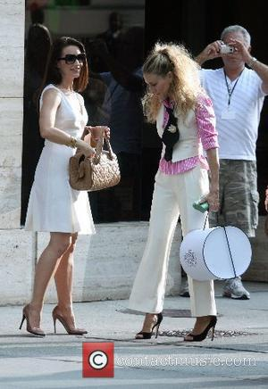 Kristin Davis, Sarah Jessica Parker The stars of 'Sex and the City: The Movie' appear together on set in NYC...