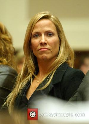 Singer/activist Sheryl Crow  testified in front of a congressional hearing on breast cancer research at the Rayburn Building Washington...