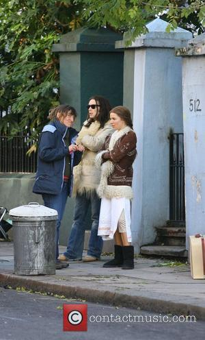 Cillian Murphy and Sienna Miller enjoying a break between filming scenes for their new movie 'Hippie Hippie Shake' in London...