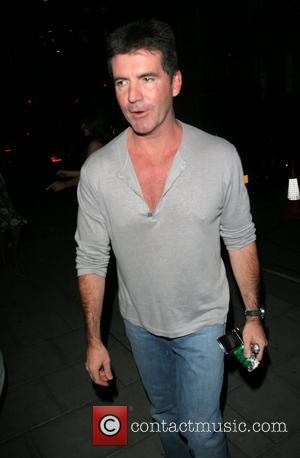 Cowell Offers Britney Help