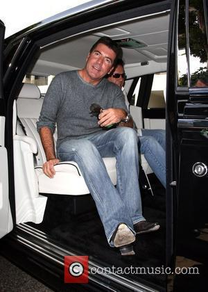 Simon Cowell Duped By Boy Band