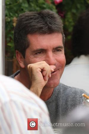 Cowell Caught 'Cheating'
