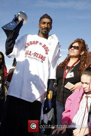 Snoop Dog holding the Snoop Bowl Trophy Snoop Bowl VI at Hamilton High School Chandler, Arizona 02.02.08