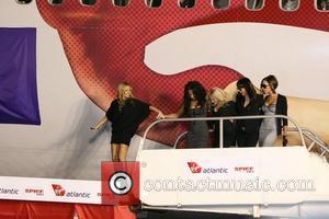 Spice Girls. From left are: Geri Halliwell, Melanie Brown, Melanie Chisholm, Emma Bunton and Victoria Beckham Virgin Atlantic names plane...