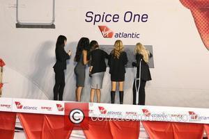 Spice Girls. From left are: Melanie Chisholm, Geri Halliwell, Emma Bunton on crutches, Melanie Brown and Victoria Beckham Virgin Atlantic...