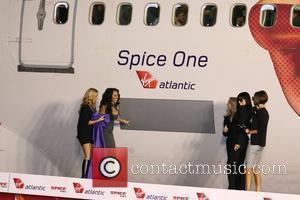 Spice Girls. From left are: Melanie Chisholm, Melanie Brown, Geri Halliwell, Emma Bunton on crutches, and Victoria Beckham Virgin Atlantic...