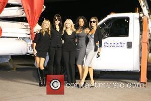 Spice Girls. From left are: Geri Halliwell, Melanie Chisholm, Emma Bunton on crutches, Melanie Brown and Victoria Beckham Virgin Atlantic...