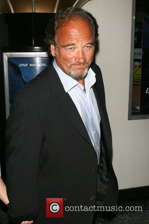 Judge Tries To Keep Belushi + Newmar Battle Out Of Court