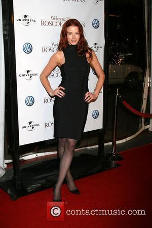 Actress Nichols Splits From Producer Husband