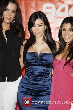 Khloe Kardashian, Kim Kardashian and Kourtney Kardashian Wyclef Jean performing live in concert on the Poniac Stage at the 944...