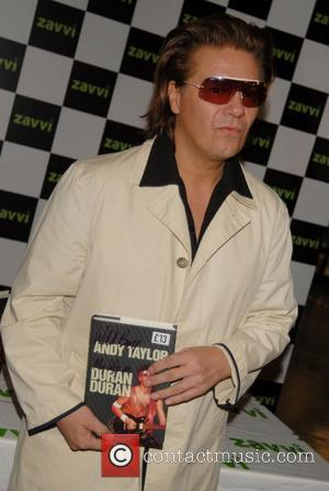 Andy Taylor of Duran Duran signing copies of his new book 'Wild Boy': My Life With Duran Duran at Zavvi,...