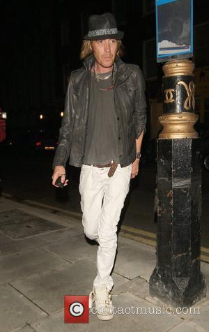 Rhys Ifans leaving the Bungalow 8 club wearing red nail varnish which matches that of his companion London, England -...