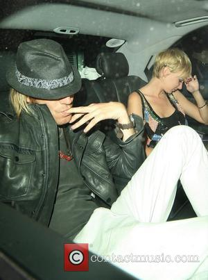 Rhys Ifans and Kimberly Stewart leaving the Bungalow 8 club wearing matching red nail varnish London, England - 12.08.08