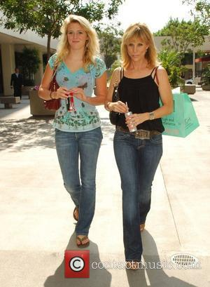 Cheryl Hines, star of cable tv series 'Curb Your Enthusiasm' and her daughter shopping at Surly Girl on Robertson West...