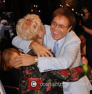 Gloria Hunniford and Sir Cliff Richard Cliff Richard's 50th Anniversary Tribute Lunch at the Dorchester Hotel to aid the Variety...