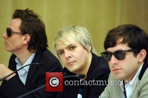John Taylor, Nick Rhodes of Duran Duran with Mark Ronson at a press conference before the Smirnoff Experience Paris at...