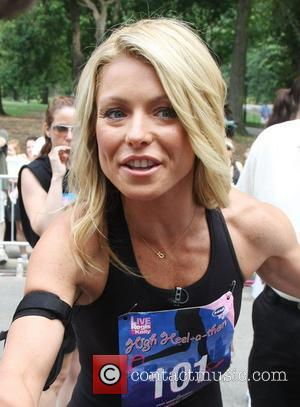 Kelly Ripa ABC's 'Live with Regis and Kelly' talk show host participates in a 'High-Heel-A-Thon' in Central Park to raise...