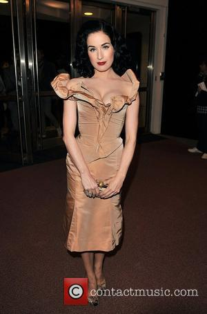 Dita Von Teese London Fashion Week Spring/Summer 2009 - Vivienne Westwood: Red Label - front row at Earls Court London,...