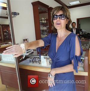 A bra-less Lisa Rinna buys two Rolex watches for her husband from Beverly Hills Watch Company Los Angeles, California -...