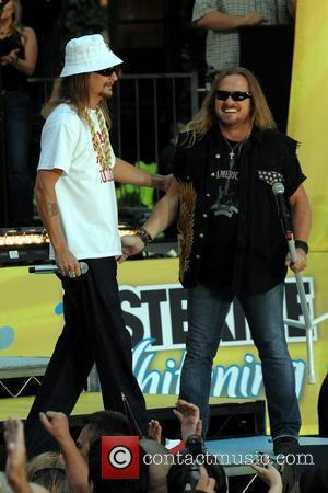 Rock Slams Winfrey's Vote